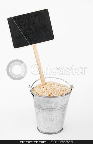 Pointer, price in bucket of  sesame seeds stock photo, Pointer, price in bucket of  sesame seeds, on a white background by alekleks