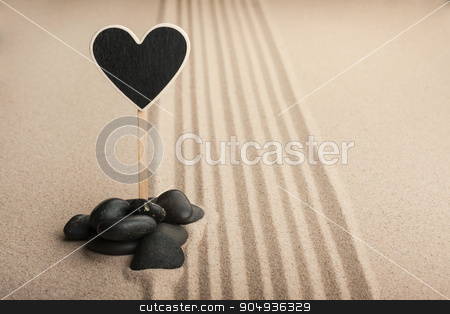 Pointer heart  standing  in the stones on the sand stock photo, Pointer heart  standing  in the stones on the sand, with place for your text by alekleks