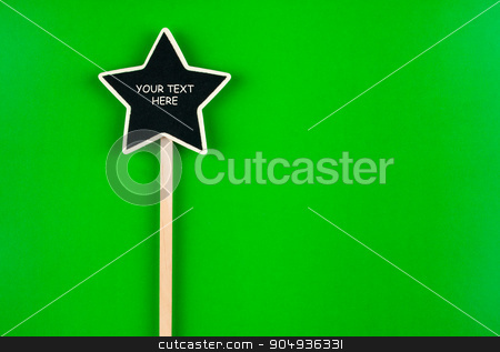 Pointer star  with space for your text stock photo, Pointer star  with space for your text, lies on green  background by alekleks