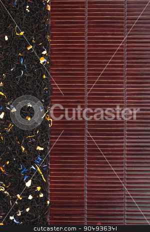 Dried  black  tea  on a dark  bamboo mat stock photo, Dried  black  tea  on a dark  bamboo mat, with space for text by alekleks