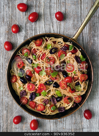 rustic italian spaghetti puttanesca pasta stock photo, close up of rustic italian spaghetti puttanesca pasta by zkruger