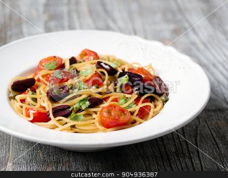 rustic italian spaghetti puttanesca pasta stock photo, close up of rustic italian spaghetti puttanesca pasta by zkruger