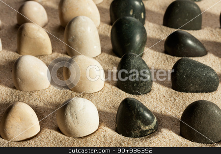 Garden of black and white stones, sticking out of the sand in th stock photo, Garden of black and white stones, sticking out of the sand in the sunlight,as a background by alekleks
