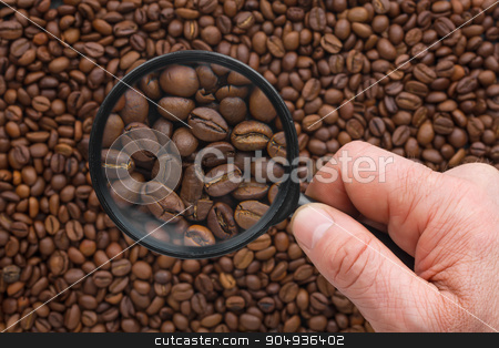 Man's hand keeps magnifying glass stock photo, Man's hand keeps magnifying glass over the coffee beans by alekleks