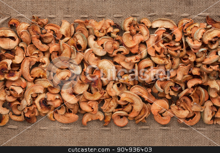 Dried  apple  lying on sackcloth between the lines stock photo, Dried  apple  lying on sackcloth between the lines, can be used as background by alekleks