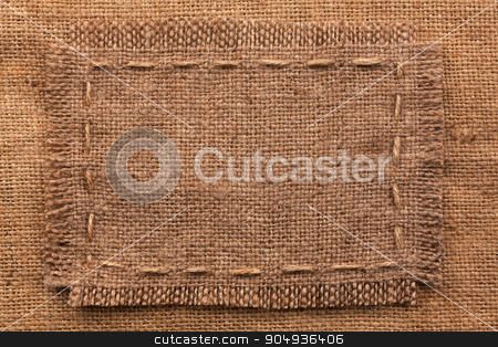 Frame of burlap, lies on a background of burlap stock photo, Frame of burlap, lies on a background of burlap, with place for your text by alekleks