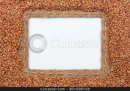 Frame made of burlap with the line and buckwheat  grain  lies on stock photo, Frame made of burlap with the line and buckwheat  grain  lies on white background, with place for your creativity by alekleks