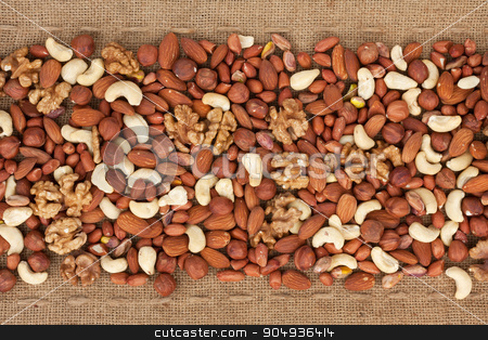 Line,dried nuts  and burlap  stock photo, Line,dried nuts  and burlap , can be used as background by alekleks