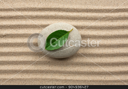 Leaf on a rock in the sand stock photo, harmony concept with zen stones and leaves  by alekleks