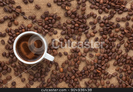 Cup of coffee with a heart is on sacking stock photo, Cup of coffee with a heart is on sacking,as background by alekleks