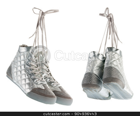 Silvery flying gym shoes with rhinestones stock photo, Silvery flying gym shoes with rhinestones, gym shoes hanging by laces, isolated by alekleks