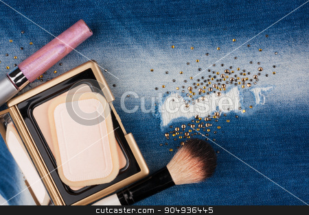 Still life from cosmetics on ragged jeans with rhinestones stock photo, Still life from cosmetics on ragged jeans with rhinestones, with place for your text by alekleks