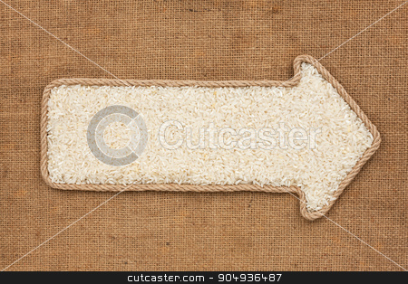 Pointer made from rope with grain rice  lying on sackcloth stock photo, Pointer made from rope with grain rice  lying on sackcloth, with space for your text by alekleks