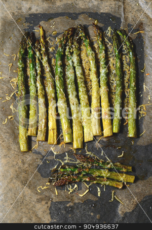 Oven roasted asparagus stock photo, Oven roasted asparagus with olive oil in a pan by sutike