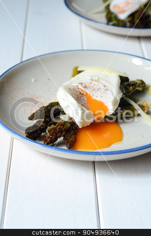 Green asparagus with poached egg stock photo, Green asparagus with poached egg on a plate by sutike