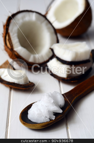 Coconut with coconut oil stock photo, Coconut with coconut oil in a spoon by sutike