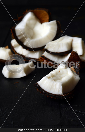 close up of coconut stock photo, close up of coconut pieces on a wooden background by sutike