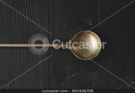 Old metal spoon stock photo, Old metal spoon on dark background with copy space by sutike