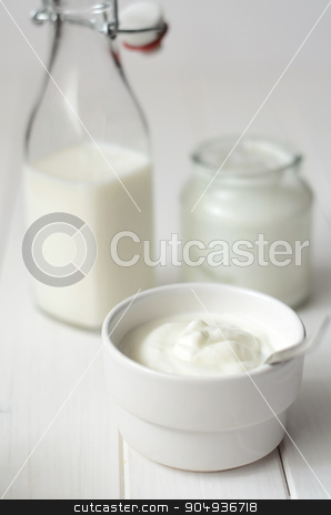 Fresh dairy products stock photo, Fresh dairy products on a white kitchen table by sutike