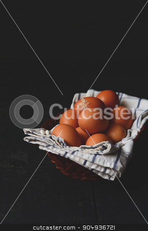 Chicken eggs on the table stock photo, Chicken eggs on a dark wooden table by sutike