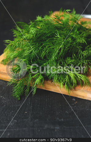 bunch of fresh  dill  stock photo, bunch of fresh organic dill on a rustic wooden background by sutike