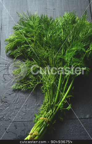 Chopping fresh dill stock photo, Chopping fresh dill with a curved mezzaluna knife by sutike