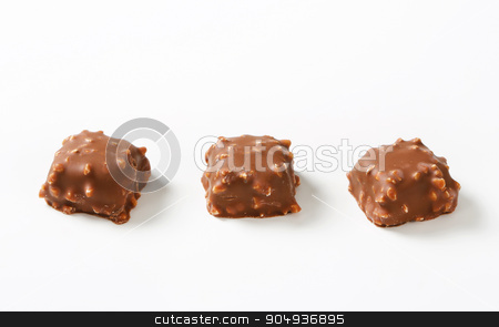 Chocolate pralines stock photo, Chocolate pralines with chopped nuts by Digifoodstock