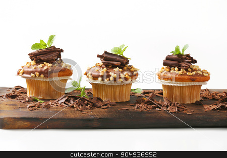 Hazelnut muffins stock photo, Hazelnut muffins with chocolate topping by Digifoodstock