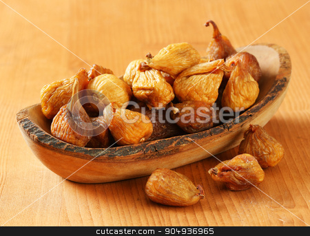 Dried figs stock photo, Dried figs in olive wood bowl by Digifoodstock