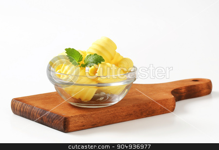 Bowl of butter curls stock photo, Curls of fresh butter in glass bowl by Digifoodstock