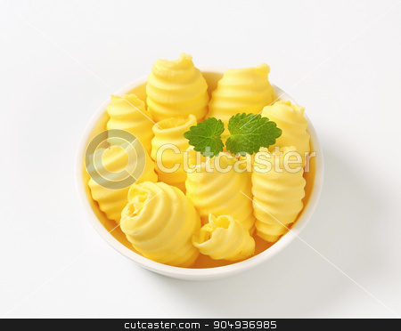 Butter curls stock photo, Curls of fresh butter in bowl by Digifoodstock