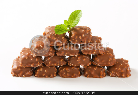 Marzipan pralines stock photo, Marzipan nuggets covered with milk chocolate by Digifoodstock
