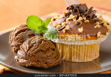 Hazelnut muffin and chocolate ice cream stock photo, Hazelnut muffin with scoops of chocolate ice-cream by Digifoodstock