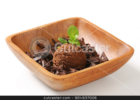 Scoop of ice cream and chocolate shavings stock photo, Scoop of ice cream and chocolate shavings in wooden bowl by Digifoodstock