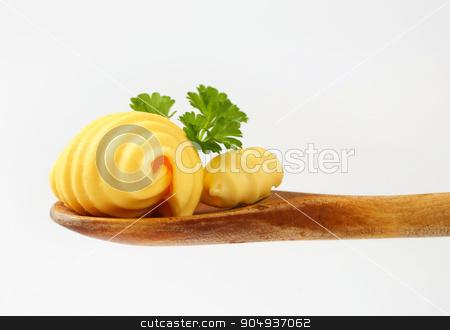 Butter curls stock photo, Butter curls on wooden spoon by Digifoodstock