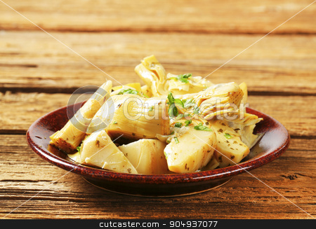 Marinated artichoke hearts stock photo, Artichoke hearts dressed in oil and herb marinade by Digifoodstock
