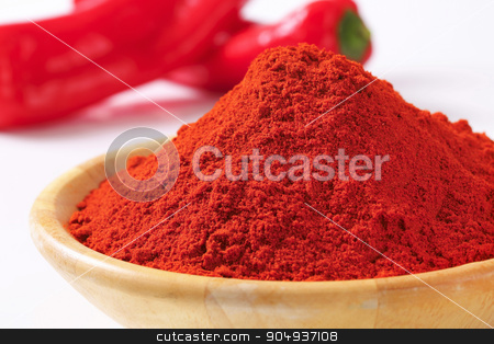 Paprika powder stock photo, Paprika powder in a wooden bowl by Digifoodstock