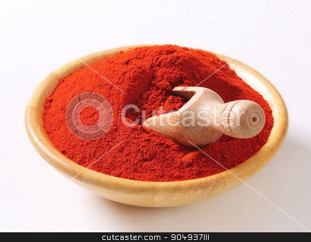 Paprika powder stock photo, Paprika powder in a wooden bowl by Digifoodstock