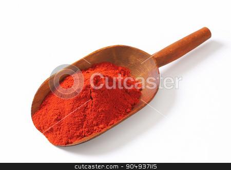 Paprika powder stock photo, Heap of paprika powder on a wooden scoop by Digifoodstock