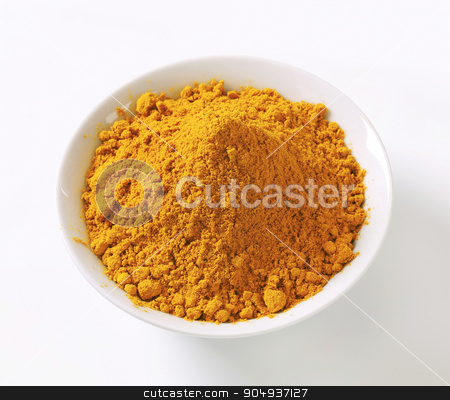 Curry powder stock photo, Heap of curry powder in a bowl by Digifoodstock