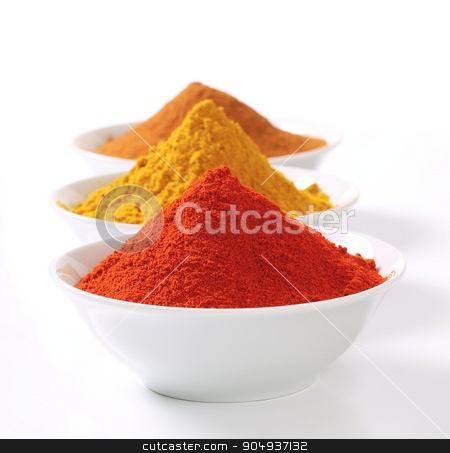 Curry powder, paprika and ground cinnamon stock photo, Bowls of curry powder, paprika and ground cinnamon by Digifoodstock