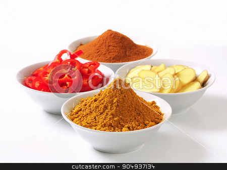 Curry powder, ground cinnamon, sliced ginger root and red pepper stock photo, Bowls of curry powder, ground cinnamon, sliced ginger root and red pepper by Digifoodstock