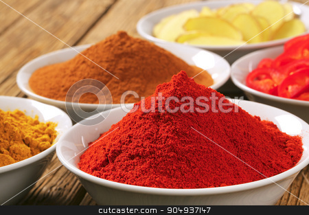 Curry powder, paprika,  ground cinnamon, sliced ginger root and  stock photo, Bowls of curry powder, paprika,  ground cinnamon, sliced ginger root and red pepper by Digifoodstock