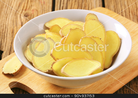 Fresh ginger slices stock photo, Fresh ginger root - thinly sliced by Digifoodstock