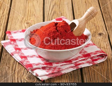 Paprika powder stock photo, Paprika powder in a bowl by Digifoodstock