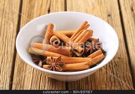 Cinnamon sticks and star anise stock photo, Bowl of cinnamon sticks and star anise by Digifoodstock