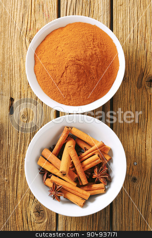 Cinnamon sticks and powder and star anise stock photo, Bowls of cinnamon and star anise by Digifoodstock