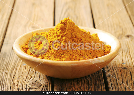 Heap of curry powder  stock photo, Heap of curry powder in a bowl by Digifoodstock