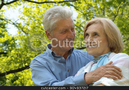 Senior couple in autumn park stock photo, Portrait of a senior couple resting at autumn park by Ruslan Huzau