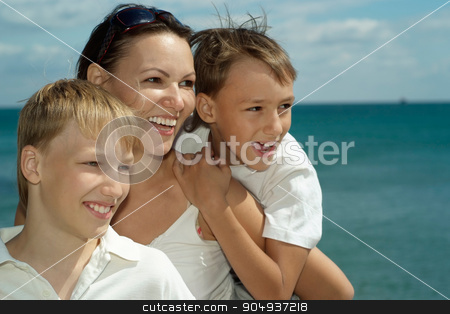 Mother and children  stock photo, Mother and children on the background of the sea by Ruslan Huzau